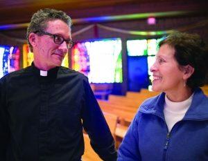 Gladys Munoz and Father Wayne Dziekan