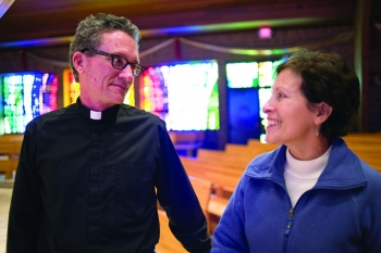 Gladys Munoz and Father Wayne Dziekan